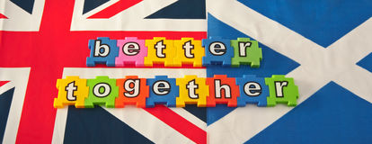 Better Together Campaign. Union Jack flag together with Scottish Saltire with colorful jigsaw style letters spelling out ' better together ' referring to the Stock Image