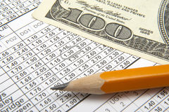 Betting 2. Close up of sports betting slip, pencil and one hundred dollars Royalty Free Stock Photography