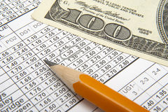 Betting 3. Close up of sports betting slip, pencil and one hundred dollars Royalty Free Stock Photography