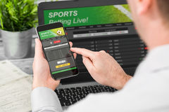 Betting bet sport phone gamble laptop concept. Betting bet sport phone gamble laptop over shoulder soccer live home website concept - stock image Stock Photo