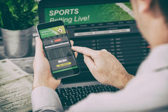 Betting bet sport phone gamble laptop concept. Betting bet sport phone gamble laptop over shoulder soccer live home website concept - stock image Stock Image