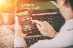 Betting bet sport phone gamble laptop concept Royalty Free Stock Photography