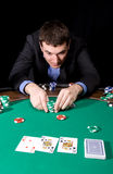 Betting in casino. Fantastic win of stylish man  in the casino over black Royalty Free Stock Photo