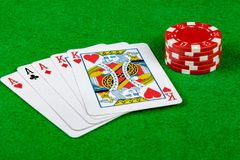 Betting chips. On a green card table with a full house, aces and kings Royalty Free Stock Images