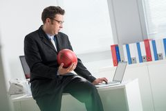 Betting on football. Businessman betting on football via internet Stock Image