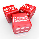Betting Franchise Start New Business License Established Chain B. Betting On A Franchise words on three red dice to illustrate gambling or taking the risk of Stock Photo