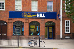 Betting. LONDON - SEPTEMBER 5TH: The exterior of a william hill betting shop on September the 5th, 2014, in London, England, UK. William Hill is the UK's leading Royalty Free Stock Images