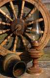 Betty Lamp, Jug And Spinning Wheel. In the background of the old log-house wall Royalty Free Stock Image