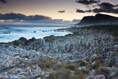 Bettys Bay Sunset. Sunset over the Bettys Bay rocky beach Royalty Free Stock Photos