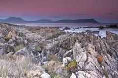 Bettys Bay Sunset. Sunset over the Bettys Bay rocky beach Stock Image