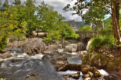 Betws y Coed. Hdr image of Betws y Coed bridge and waterfall in Wales royalty free stock images