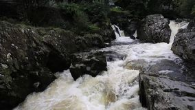 Betws-y-Coed Wales UK Snowdonia National Park with its fast flowing river with white water flowing over rocks stock video footage