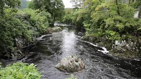 Betws-y-Coed Wales UK Snowdonia National Park river flowing through beautiful Welsh village stock video