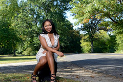 Free Beuatiful African American Woman Sitting Next To Road Stock Photos - 50583313