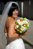 Beuatiful Bride with Flowers Stock Photo