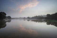 Beuatiful dawn sunrise landscape over misty lake in Summer Stock Photo