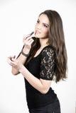 The beuatiful girl applying lipstick Stock Photo