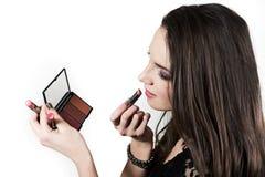 The beuatiful girl applying lipstick Stock Photos