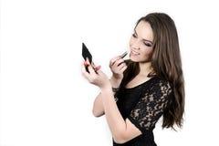 The beuatiful girl applying lipstick stock images
