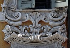 Beuatiful house facade with carved stone animals in Mantua, Italy.  Royalty Free Stock Image