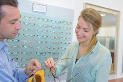 Beuatiful woman buying glasses Stock Image