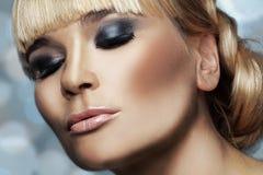 Beuatiful woman. Studio shot of beautiful woman with smokey eyes makeup Stock Photos