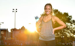 Beuatiful young fitness model at sunset Royalty Free Stock Image