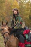 Beuatiful young girl on horseback. Beuatiful young girl dressed as gypsy on horseback Royalty Free Stock Photo