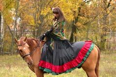 Beuatiful young girl on horseback. Beuatiful young girl dressed as gypsy on horseback Royalty Free Stock Photography