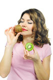 Beuatiful young girl smelling kiwi isolated on white Royalty Free Stock Image
