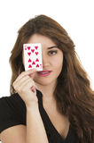 Beuatiful young woman playing cards Stock Image