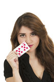 Beuatiful young woman playing cards Royalty Free Stock Photos