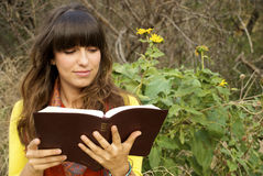 Beuatiful Young Woman Reading Stock Photos