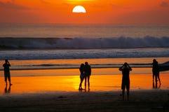 beundra solnedgång Arkivbild