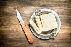 Beurre avec le couteau Photos libres de droits