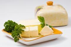 Beurre avec le persil Images stock