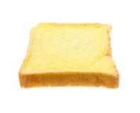 Beurre coupé en tranches de pain Photographie stock libre de droits