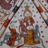 Beurre de barattage avec des diables, fresque gothique Photographie stock