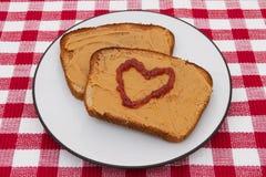 Beurre et confiture d'arachide d'amour Photographie stock libre de droits