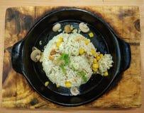 Beurre Friedrice avec le maïs et les champignons Image libre de droits