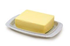 Beurre sur le butterdish gris Photos stock