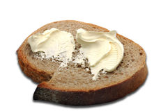 Beurre sur une tranche de pain Photographie stock