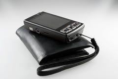 Beurs en mobiele telefoon Stock Afbeelding