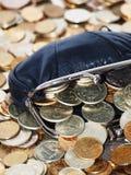 Beurs met muntstukken en dollars Stock Foto