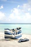 Beutel auf dem Strand Stockbild