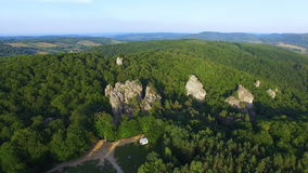 Beutiful aerial view of cliff in Karpatian mountains. Fly into. 4K stock footage