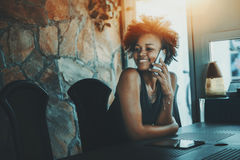 Beutiful black curly woman waiting in dark office room Royalty Free Stock Images
