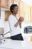 Beutiful black women at home smiling Stock Images