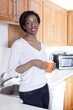 Beutiful black woman at home smiling Stock Photo