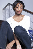 Beutiful black woman relaxed at home. Beautiful blck women relaxed sitting in the stairs at home Stock Photos